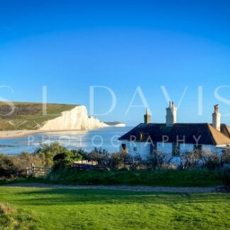 Blue Skies over Coastguard Cottages - S L Davis Photography